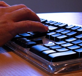 Fingers typing on a computer keyboard